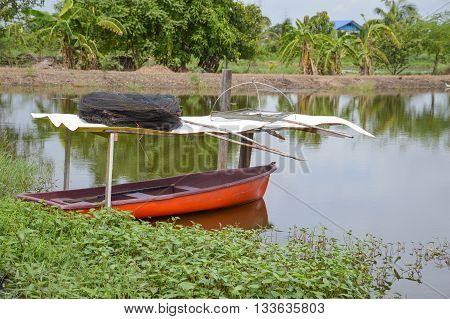close up plastic boat on fish pond