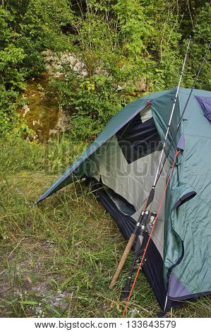 fishing rods standing at the tent on nature