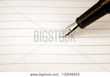 Blank card with lines and the pen oldened