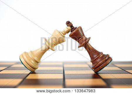 Kings chess duel. Duel rulers. Wooden chess pieces