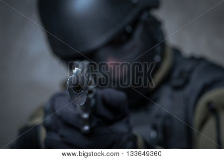 Terrorist In Helmet With Big Gun In Hands
