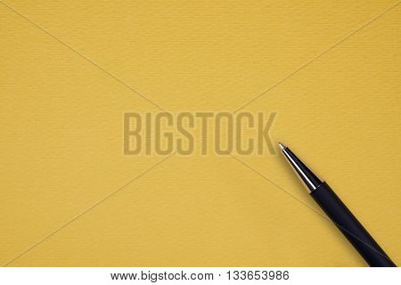 Yellow papper background with black ball pen and text space