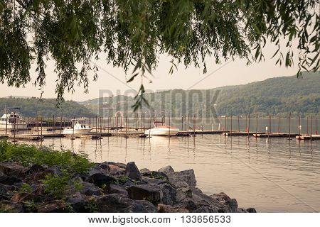 Early morning view of boat dock in Cold Spring New York. West Point Military Academy is across the river.