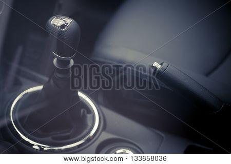 Close up shot of a gear stick inside a car.
