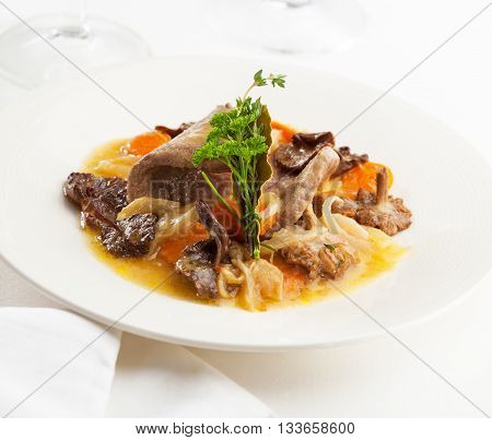 A delicious plate of fricandeau with mushrooms