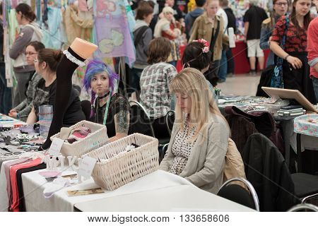 Two Saleswomen At Markets With Clothing Accessories At Animefest