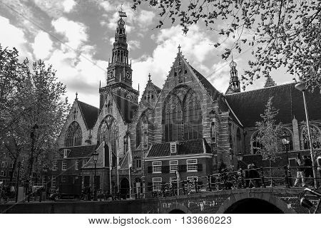 AMSTERDAM, NETHERLANDS - MAY 4, 2013: This is oldest church of Amsterdam Oude Kerk in black & white picture.