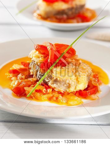 Fried conger with stir fried onions garlic and tomato