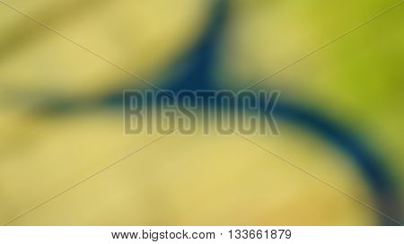 Abstract Unfocused Colorful Green Yellow Background Texture Pattern with Dark Stripes