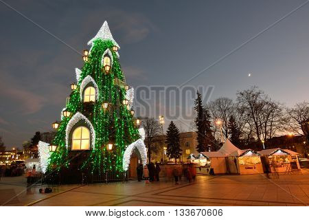 VILNIUS LITHUANIA - DECEMBER 16: night view of the christmas tree in Vilnius on December 16 2015 in Vilnius Lithuania. In 1994 the Vilnius Old Town was included in the UNESCO World Heritage List.