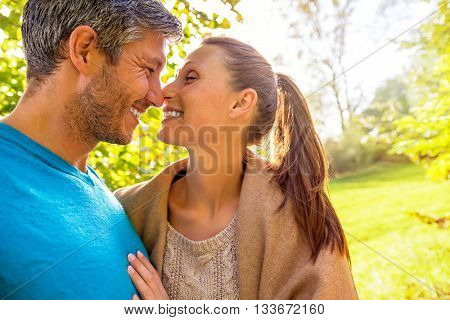 spring autumn outdoor couple with sun behind