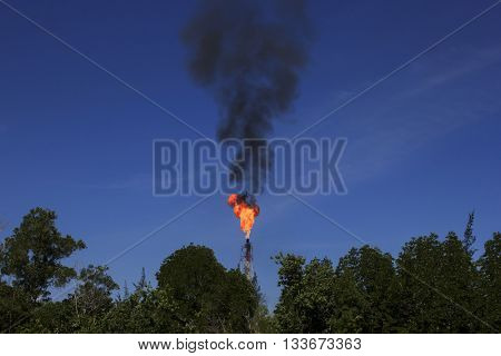 Greenhouse gas pollution: Oil refinery combustion of associated gas causing pollution leading to global warming climate change