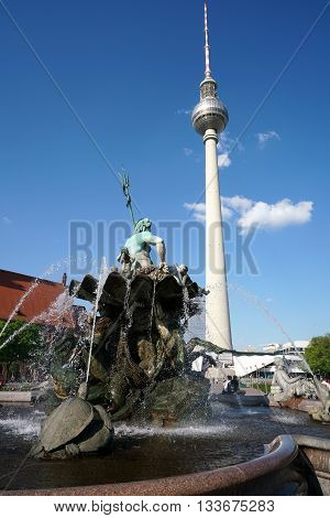 BERLIN , GERMANY - MAY 09, 2016: TV tower and Neptune Fountain in Berlin. Two landmark and tourist magnets in downtown Berlin