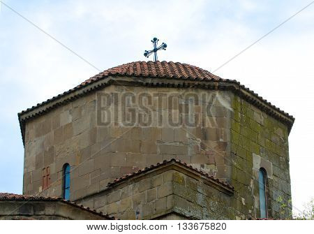 The dome of the ancient monastery Jvari close up against the sky