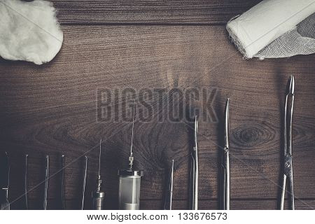 surgical armaments on the brown wooden background