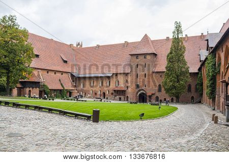 MALBORK, POLAND - SEPTEMBER 24: Courtyard of the gothic castle of the Teutonic Knights on September 24, 2011 in Malbork.