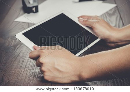 women hands with tablet computer on the table