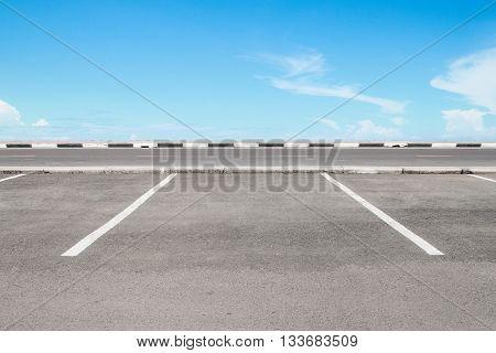 Empty parking lot area with sky landscape