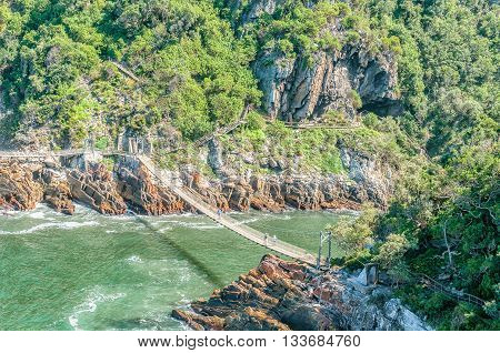 STORMS RIVER MOUTH SOUTH AFRICA - FEBRUARY 29 2016: An aerial view of the suspension bridge over the mouth of the Storms River