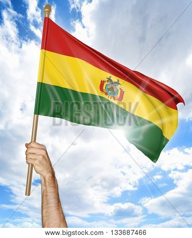Person's hand holding the Bolivian national flag and waving it in the sky, part 3D rendering