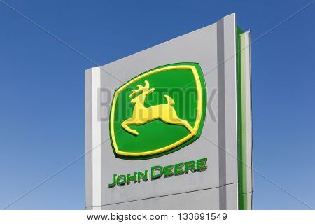 Flensburg, Germany - June 4, 2016:  John Deere sign on a panel. John Deere is an American corporation that manufactures agricultural, construction, and forestry machinery, diesel engines