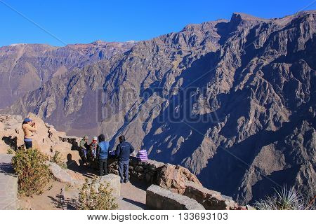 COLCA CANYON, PERU-JANUARY 15: Unidentified people stand at Mirador Cruz del Condor on January 15, 2015 in Colca Canyon, Peru. It is one of the deepest canyons in the world with a depth of 3270 meters