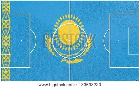 Kazakhstan flag textured football field. Soccer relative theme. 3D rendering