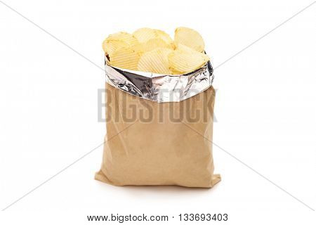 Studio shot of a brown bag full of potato chips isolated on white background