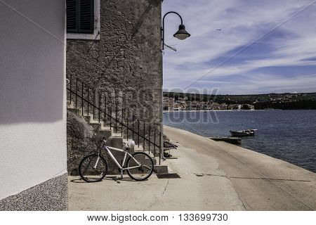 Wonderful landscape of seaside promenade and bicycle on it.