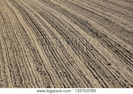 Furrows on a freshly ploughed field in March