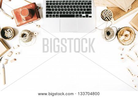 flay lay composition for bloggers artists magazines and social media. freelancer retro brown style workspace with laptop vintage photo camera craft envelope tools and twine on white background.