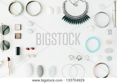 woman summer accessories collage on white flat lay top view