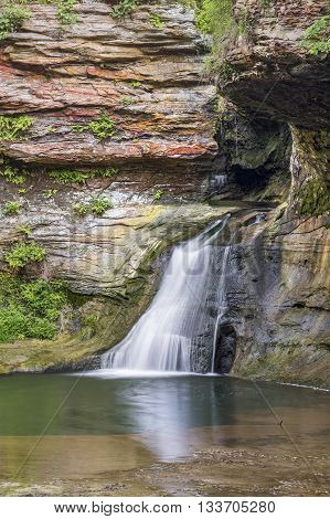 Early in its journey the Hocking River cuts through a sandstone gorge and spills over a beautiful small waterfall in Fairfield County Ohio.