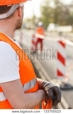 Construction worker in high-visibility clothes on the building site