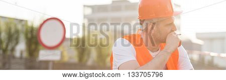 Tired blue collar worker with a cigarette