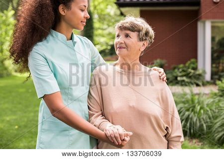 Carer And Patient Relaxing Outdoor