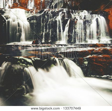 Cascading Waterfall Nature Greenery Concept poster