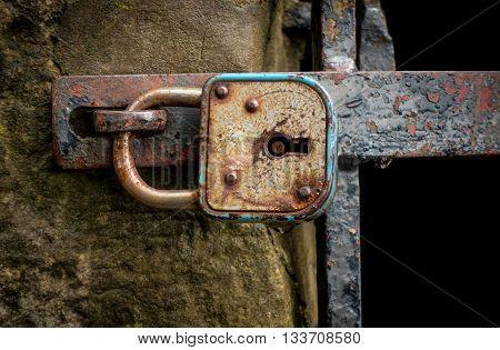 The metal lock on a door .