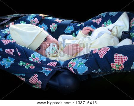 little beautiful baby in comfortable blu carseat