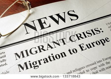 Newspaper with header news and Migrant crisis: Migration to Europe. poster