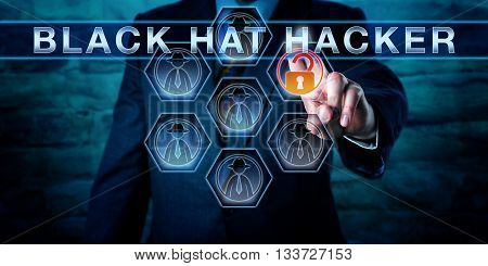 Businessman pushing BLACK HAT HACKER on an interactive virtual touch screen interface. Computer security metaphor and cybersecurity concept for a computer criminal gaining unauthorized data access.