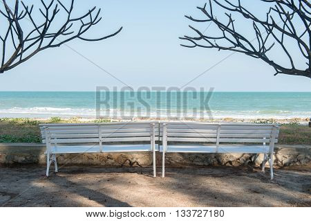 The white bench on the beach seaside