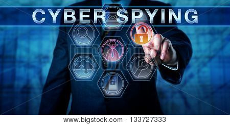 Business man pushing CYBER SPYING on an interactive touch screen monitor. His left hand is highlighting investigative tool icons. Computer security concept for sabotage and espionage in cyber space.