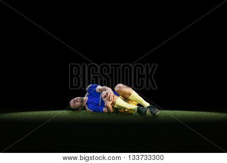 Soccer player have pain injury accident on football training on green grass