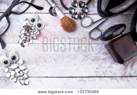 Feminine cosmetic background. Overhead of essentials of a modern woman.