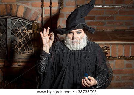 Old Wizard In Black Costume