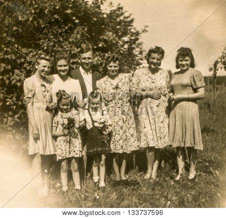 LODZ, POLAND, CIRCA 1940's: Vintage photo of family outdoor