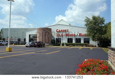 SHOREWOOD, ILLINOIS / UNITED STATES - AUGUST 16, 2015: The Floor Covering Associates (FCA) of Joliet showroom offers various types of flooring, including carpet, tile, wood, and rugs.