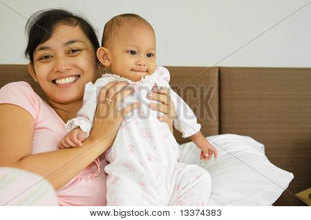 Happy Asian Mother And Baby