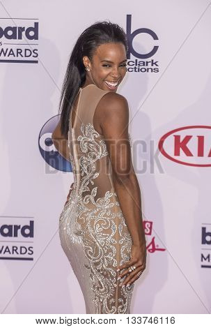 LAS VEGAS - MAY 22 : Recording artist Kelly Rowland poses in the press room at the 2016 Billboard Music Awards at T-Mobile Arena on May 22 2016 in Las Vegas Nevada.